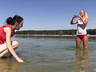 After walking Ester coupled with her girlfriend Sara enjoy sexual intercourse in nature