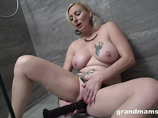 Good-looking flaxen-haired woman works her new dildo in a blue unaccompanied
