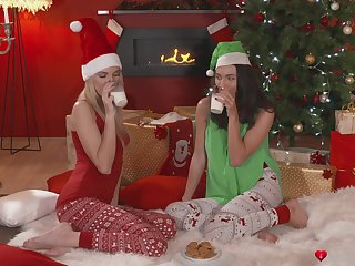 Horny sapphic sluts lick each other's cunt during the Christmas eve